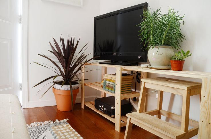Cai goes to San Francisco State University for woodwork, so she tackled the challenge of modifying the IKEA HEJNE to a media stand. She bought the planter at Lowes and painted a face on it.