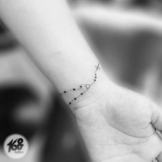 small rosary tattoo on wrist
