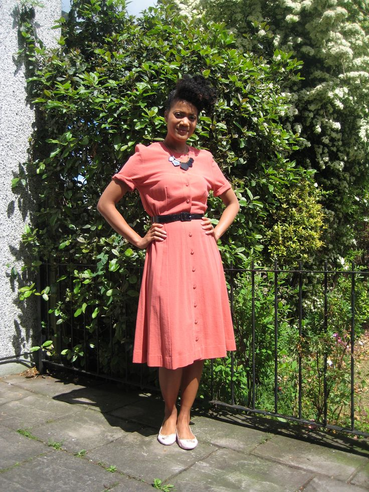 Beautifully vintage! SIze 10 orange button through dress (belt not included). Contact polkadottytheresa@gmail.com for info
