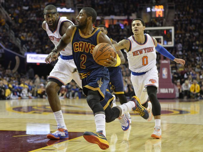 Cavaliers point guard Kyrie Irving drives past Knicks