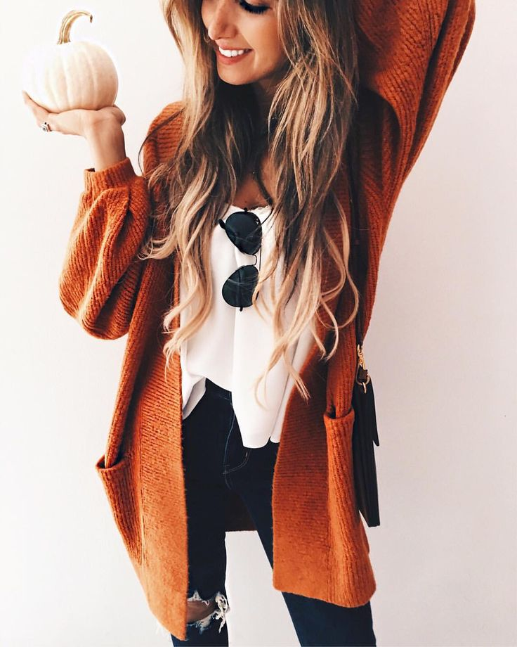 Orange cardigan + white top + black jeans