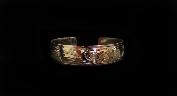 """Eagle Bracelet, Joe Descoteaux. Hand carved sterling silver, 0.63"""". Northwest Coast First Nations Jewelry."""