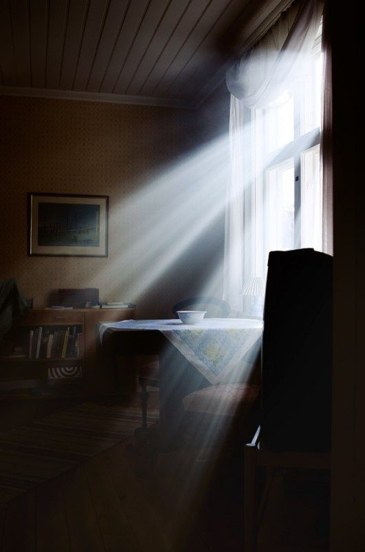 Sun's rays shining on kitchen table.