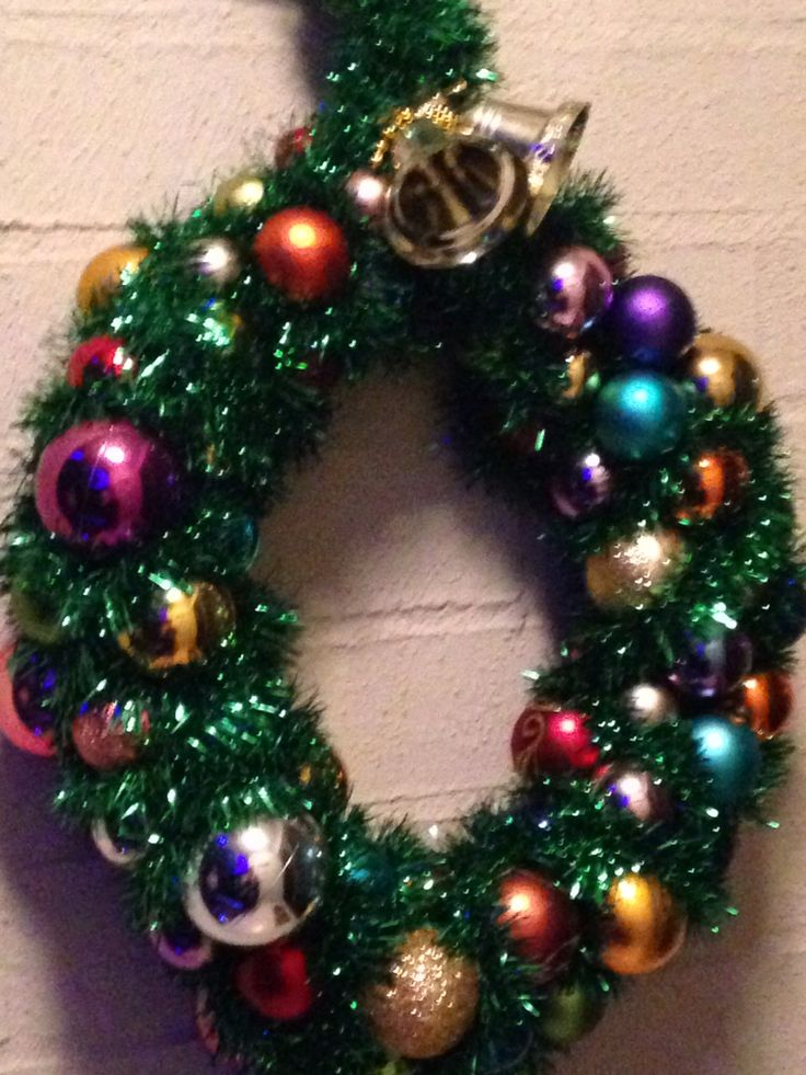 DIY xmas wreath made from wire hanger,tinsel and baubles