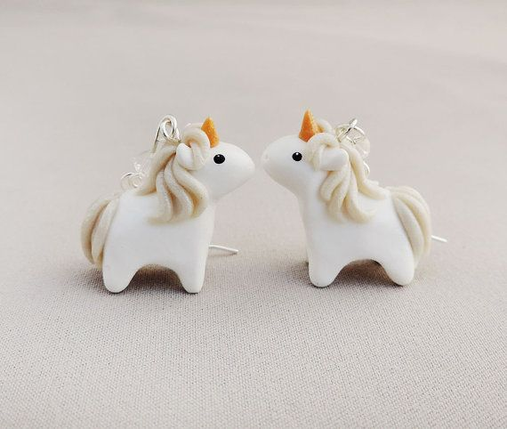 A pair of miniature unicorn earrings with clear Swarovzki crystals on sterling silver filled french earring hooks. Each earring measures 1.75 long.