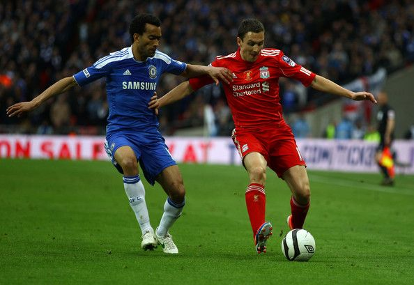 Stewart Downing of Liverpool holds off Jose Bosingwa of Chelsea during the FA Cup with Budweiser Final match between Liverpool and Chelsea at Wembley Stadium on May 5, 2012 in London, England.