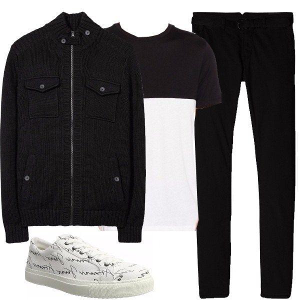 Outfit composto da pantalone nero, t-shirt bicolore bianca e nera, cardigan nero con cerniera reso particolare dai taschini e sneakers Armani bianche con scritte nere.