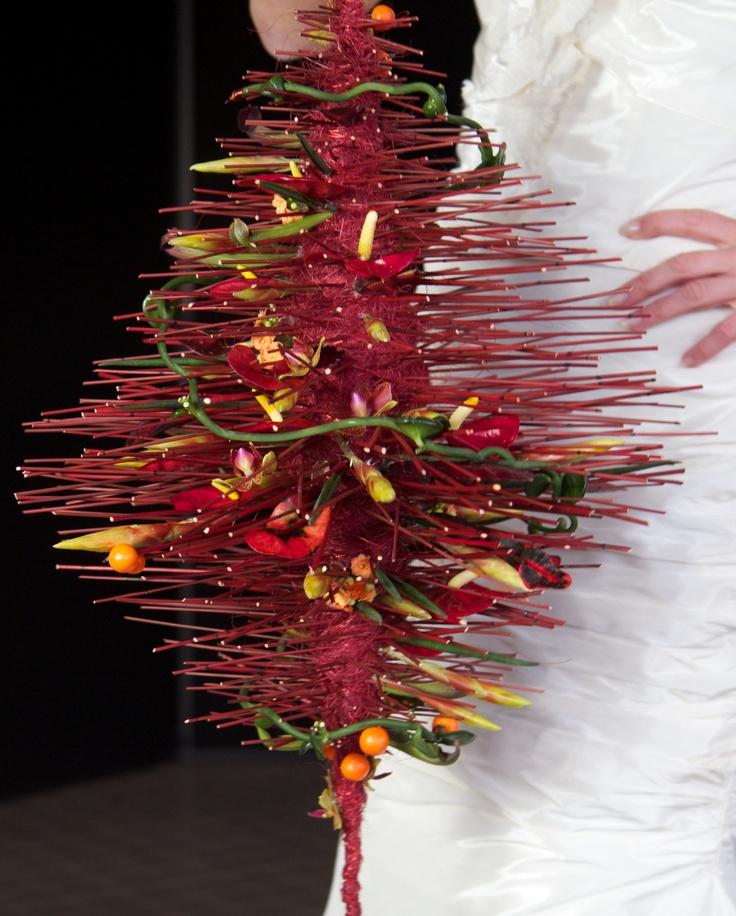 tropical arrangement with ceropegia, anthurium, croton, phalaenopsis, sanseveria, vrisea, solanum, sarracenia