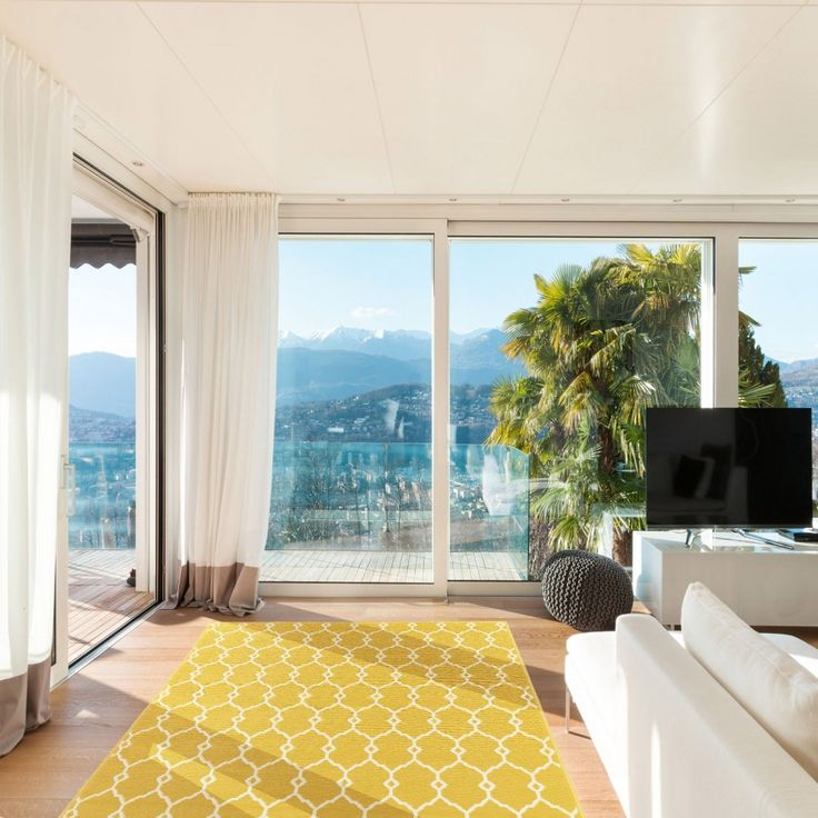 The unique design of the Vitaminic Trellis Yellow Geometric Designer Rug offers an abstract-intricate design displayed in shades of bright and loud yellow and brilliant white. The beauty of this versatile rug is that it can be used for both indoors and outdoors. These rugs are power loomed using 100% enhanced polypropylene and they include a non-slip backing. #geometricrugs #modernrugs #yellowgeometricrugs #durablerugs