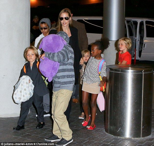 What a handful! Angelina Jolie was seen at the airport with her six children at Los Angeles on Wednesday
