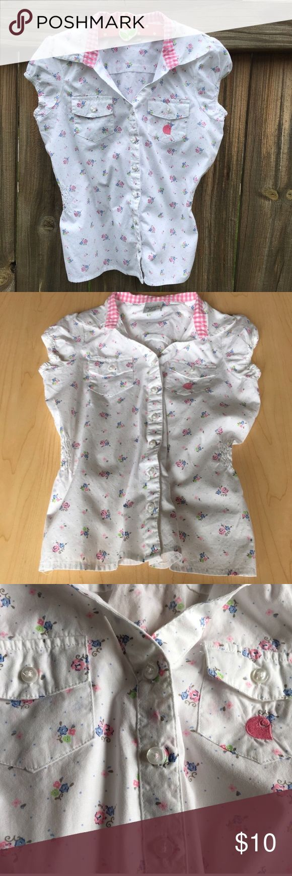 Girls Carhartt Shirt Beautiful girls Carhartt button down short sleeve shirt size 7.  Pretty flowered design with vibrant colors.  Back has a gathered bottom.  In EXCELLENT condition!  From a pet and smoke free home! Carhartt Shirts & Tops