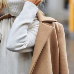 A camel coat + white turtleneck sweater.