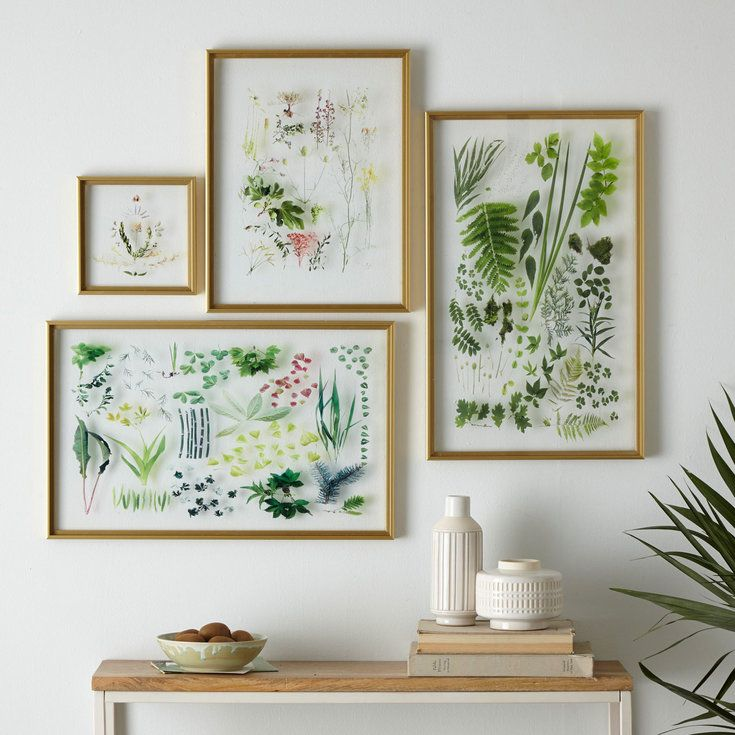 Pressed flowers hack At first, we thought these frames displayed real flowers and foliage. They don't. Keep preserved botanicals as art without the fear of discoloration. Blogger and artist Mary Jo Hoffman (stillblog.net) creatively arranges and photographs fresh cuts. West Elm took her photos and printed them on clear acrylic panels to create a faux pressed flower effect.