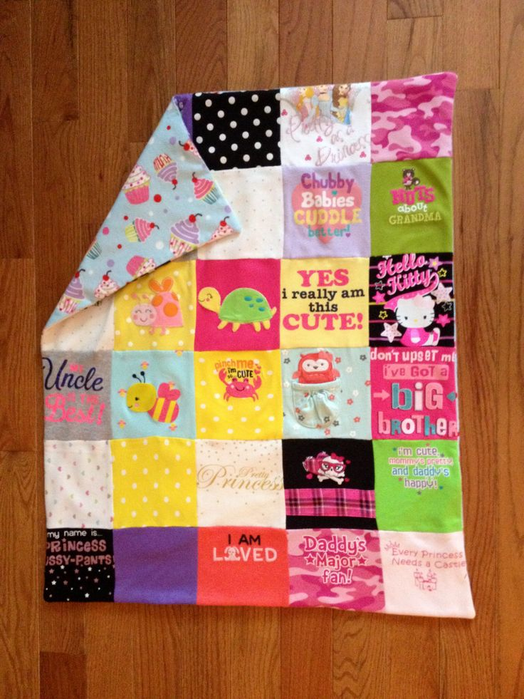 I used some of my fiancé's niece's onesies from her first year & made this adorable quilt for her 1st birthday.