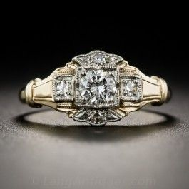 Strikingly designed and crafted in platinum and yellow gold, this mid-century (1950s) sparkler features a bright white and brilliant modern-cut diamond, weighing .28 carat, beaming from the center of a glittering 'cigar band' style mounting. A distinctive vintage dazzler. The cinched shoulders lead to a currently size 5 3/4 ring shank.