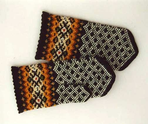 High quality hand knitted warm wool mittens , gloves patterned Black and White with wide Decorative Orange border. $50.00, via Etsy.