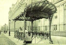 Example of architecture/furniture in the style of Hector Guimard. Designed in 1900. ~  The round, curvy feel adds a different and more easy going feeling when contrasted with the sharp, straight lines and planes of the architecture that backdrops it.