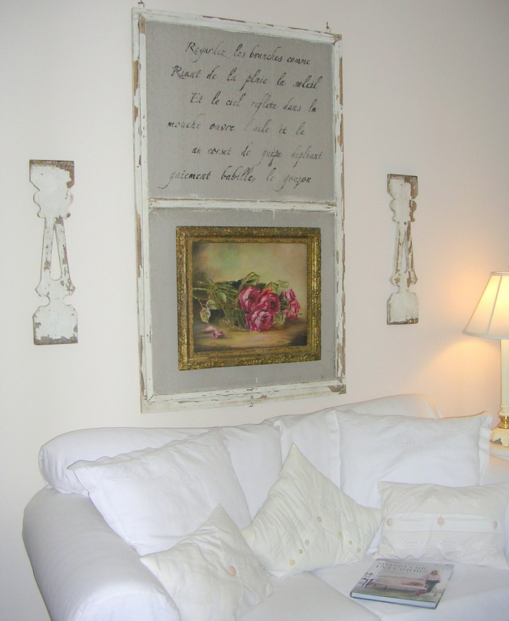 French phrase painted onto old window screen. Side pieces are balustrades from an old front porch. Monogrammed vintage Euro shams and throw pillows made from an antique English crib duvet.