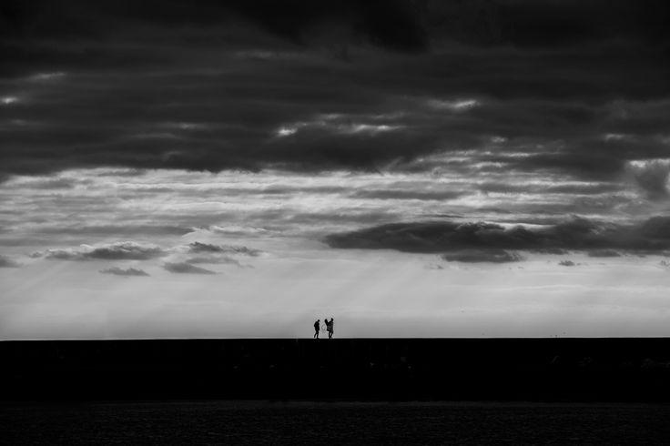 The Fishermen - Two fishermen walkin on the pier Viareggio 28/12/2015 Italy   photo by Khalil Emede