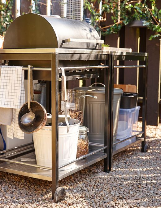 A grill with space for storing charcoal or a gas bottle underneath, as well as wood chips for smoking food.