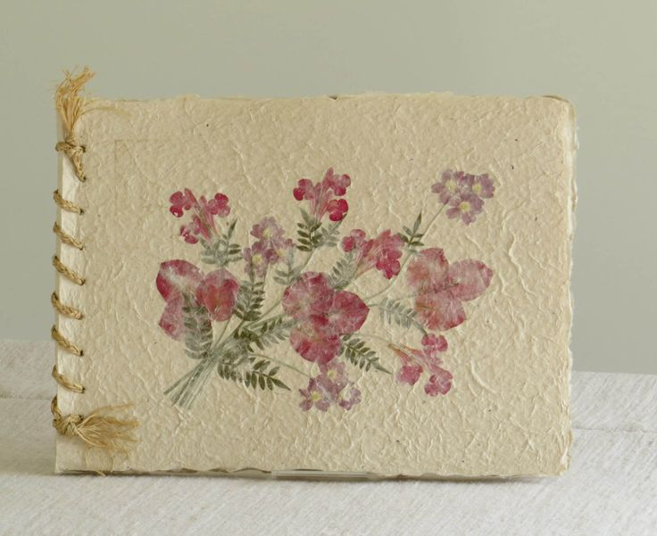 Fair Trade album made of bark, water, fresh flowers - and lots of craftskills.