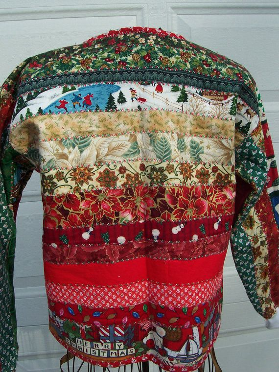 Merry Christmas Blocks is a youth size large/adult size small quilted sweatshirt jacket featuring at least 20 different Christmas fabrics in reds, greens and accents of golds. Wooden blocks spelling out Merry Christmas and childrens toys are featured in several places on the jacket. I raw-edge quilted the fabrics to a sweatshirt and embellished them with machine embroidery stitches in red and green. The edges with softly fray as the jacket is worn and laundered. The inside of the jacket is…