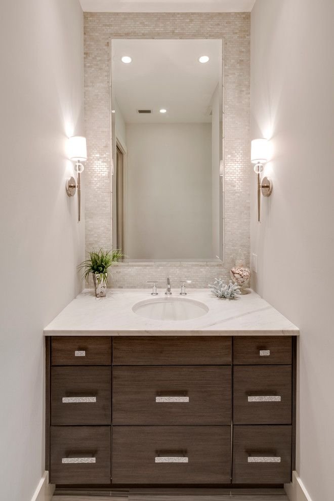 goodall homes Beach Style Powder Room Decorators Other Metro backsplash brown vanity kids bath lighting master bath mirror mosaic tile accent wall paint powder room recessed lighting rectangular mirror sconce silver accents sink spa storage Tile trim vanity wall sconces white walls white backsplash white countertop widespread faucet wood vanity
