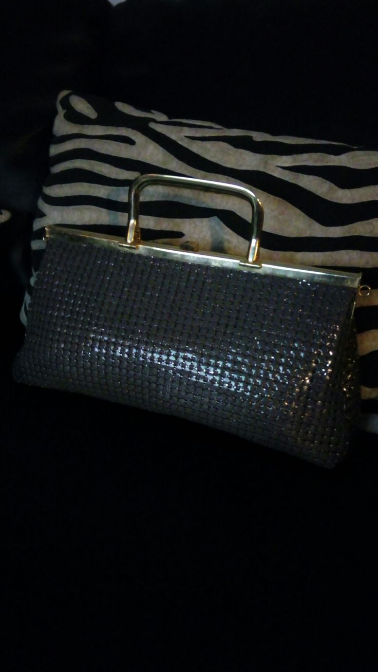 Vintage 90's mesh classic clutch bag in dark grey with gold tone metal frame and carry handles