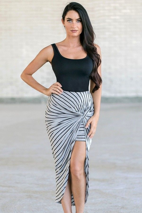 Comfortable cannot get any cuter!! This soft knit skirt has a unique twisted front that creates an asymmetrical hemline. The Earning Stripes Twist Front Midi Skirt is lined to mid-thigh. We love this unique skirt! The mini skirt is wrapped around and twisted in the front to create a dramatic high low look. The gray background is brought to life with thin black stripes throughout. This soft knit fabric is stretchy and has an elastic waist. This skirt would look really cute with a crop top…