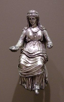 "Juno is an ancient Roman goddess, the protector and special counselor of the state. She is a daughter of Saturn and sister (but also the wife) of the chief god Jupiter and the mother of Mars and Vulcan. Juno also looked after the women of Rome.[1] Her Greek equivalent is Hera. As the patron goddess of Rome and the Roman Empire she was called Regina (""queen"") and, together with Jupiter and Minerva, was worshipped as a triad on the Capitol (Juno Capitolina) in Rome"