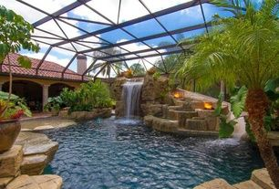 Mediterranean Swimming Pool with Fire pit, Raised beds, Indoor pool, exterior stone floors