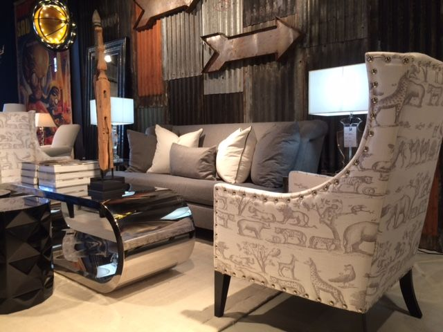 Shown is our Pluto Chair with Jungle fabric, Jantar Mantar Coffee and Crawford Sofa. All can be found at the Florida Showroom. #andrewmartin #interiordesign #decor #animal #fabric #textile #steel #pillows #steel #arrow #decor #livingroom #sofa #chair #grey #white