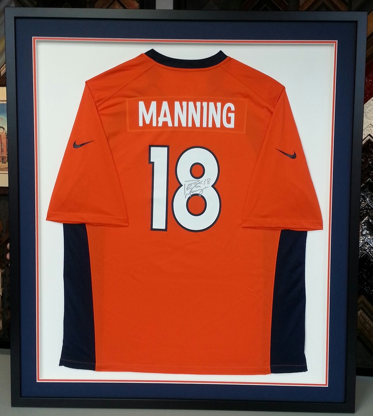 Custom framed Peyton Manning Denver Broncos jersey. FastFrame of LoDo donated the framing of this piece to the American Heart Association-Denver.