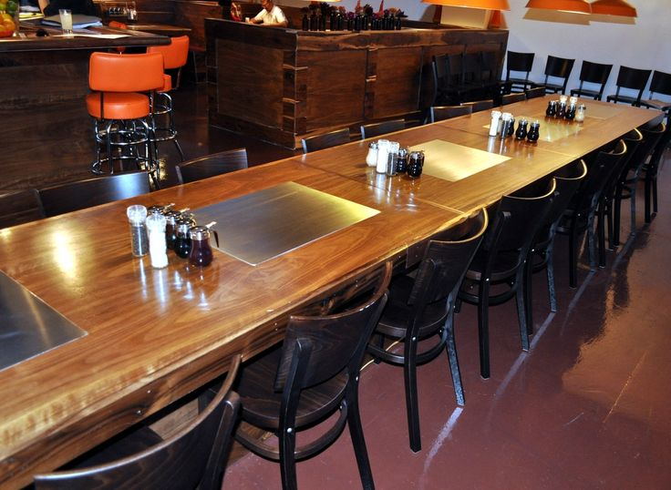A great shot of the custom walnut dining tables at Slappy Cakes in Portland, featuring our built-in model MO-60.