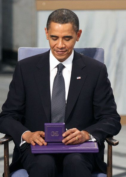 US President Barack Obama accepts the Nobel Peace Prize during a ceremony at the City Hall in Oslo.