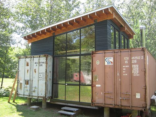 Paul Stankey, along with wife Sara and his brother Paul and wife Krista, constructed their weekend getaway in the Minnesotta woods from 2 small shipping containers ($800 each) and birch wood. Holyoke Cabin was built completely by hand, without electricity, and water was pumped from a creek 1/4 mile away to mix concrete. Paul is co-founder of HIVE Modular, specializing in modern prefab design that is affordable and efficient.