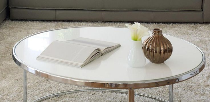 The TIARNI range includes a Coffee Table and Lamp Table featuring a white glass…