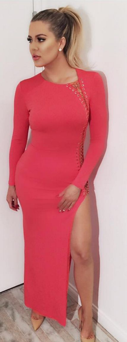 Who made  Khloe Kardashian's pink long sleeve lace up gown and nude pumps?