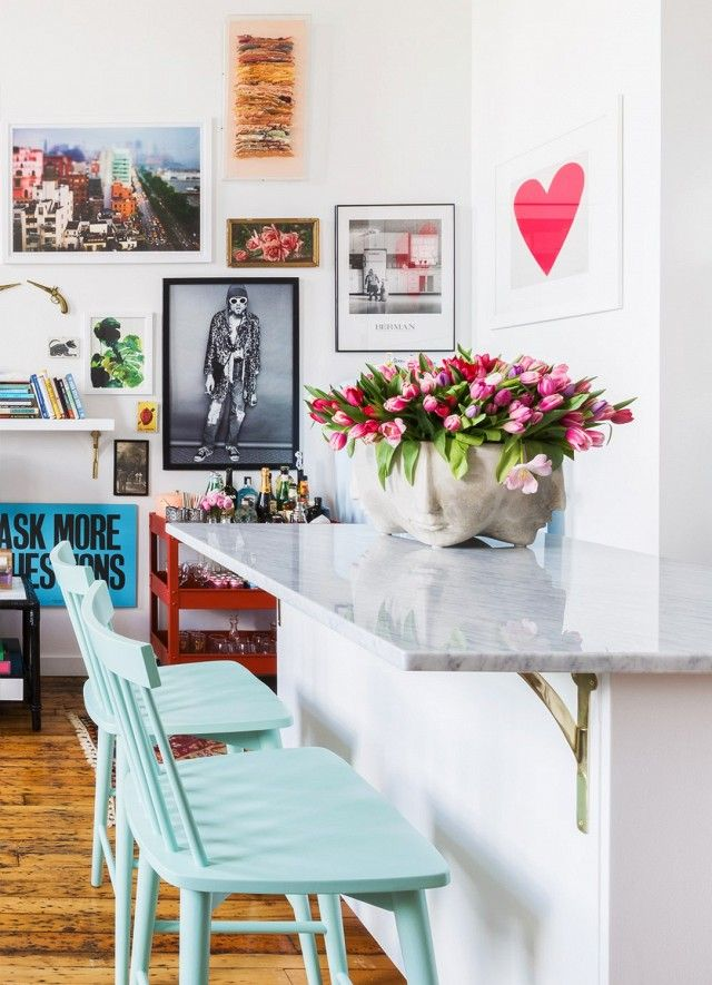 """""""We made cosmetic changes to the kitchen, bathroom, and foyer, including new tile, paint, marble countertops, cabinet hardware, and lighting,"""" she said. """"We also removed a small wing wall from the..."""