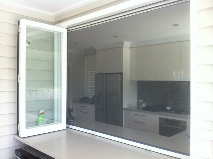 Retractable fly screen on a bi-fold servery  -  Connect with us at www.Facebook.com/TinyHousesAustralia