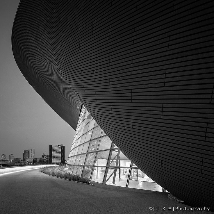 London Aquatic Centre, QEOP. Olympic seating now removed to reveal the wavelike form of the roof, and flood the pool with natural light.