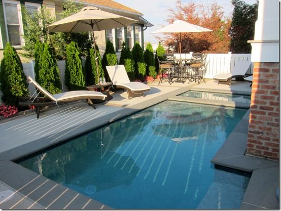 awesome job fitting a courtyard pool in this narrow space