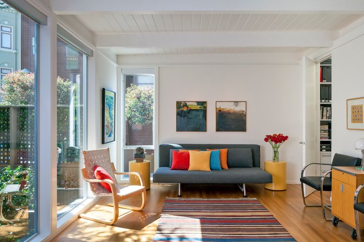 Glamorous leather futon in Family Room Modern with Buffet Table Ideas next to Benjamin Moore Swiss Coffee alongside Futon and Grey And Orange