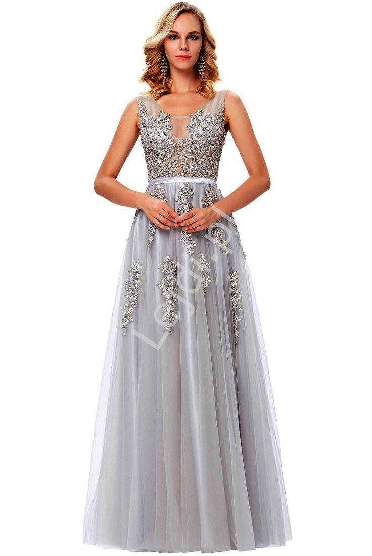Przepiękne tiulowa szara elegancka suknia wieczorowa. Sukienka zdobiona na całości gipiurowymi aplikacja. Bogate obszycie sprawia, że suknia ma niepowtarzalny wygląd.Sukienka idealna na studniówkę, wesele, sylwestrowy bal czy karnawał.Gorgeous tulle gray elegant evening dress. Dress decorated with a whole gypsy app. Rich trim gives the dress a unique look. The dress is ideal for a prom, bridal, New Year's Eve ball or carnival.dress, dress, tulle, long dress,