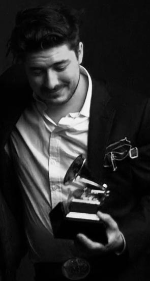 Perfect picture <3  Marcus Mumford and his well deserved GRAMMY