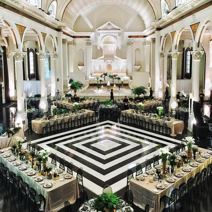 The design of this repurposed cathedral is extraordinary on its own, but we love how the graphic dance floor offers an unexpected touch of modern edge! Instagram repost: nicolesyandco   WedLuxe Magazine