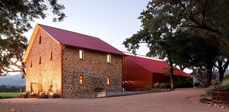 San Francisco-based Walker Warner Architects added onto this 1886 stone winery building in Napa; the new buildings take their inspiration from the agricultural architecture of Napa Valley