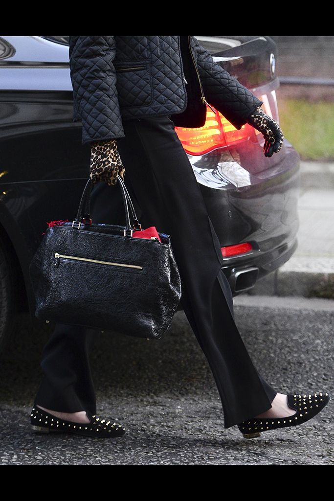 A rock'n'roll look for Theresa May, who's wearing studded loafers and animalier gloves at the Cabinet meeting in 2014.