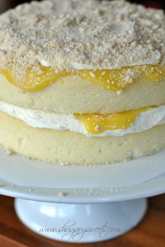 Lemon Cake with a layer of creamy lemon frosting and fresh lemon curd