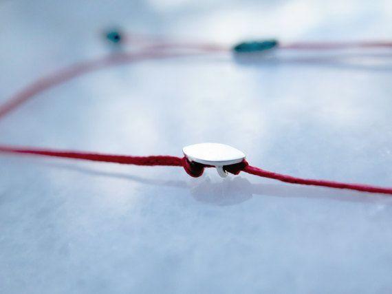 Tiny Silver Evil Eye Bracelet // Red thread by ALKISTIjewelry